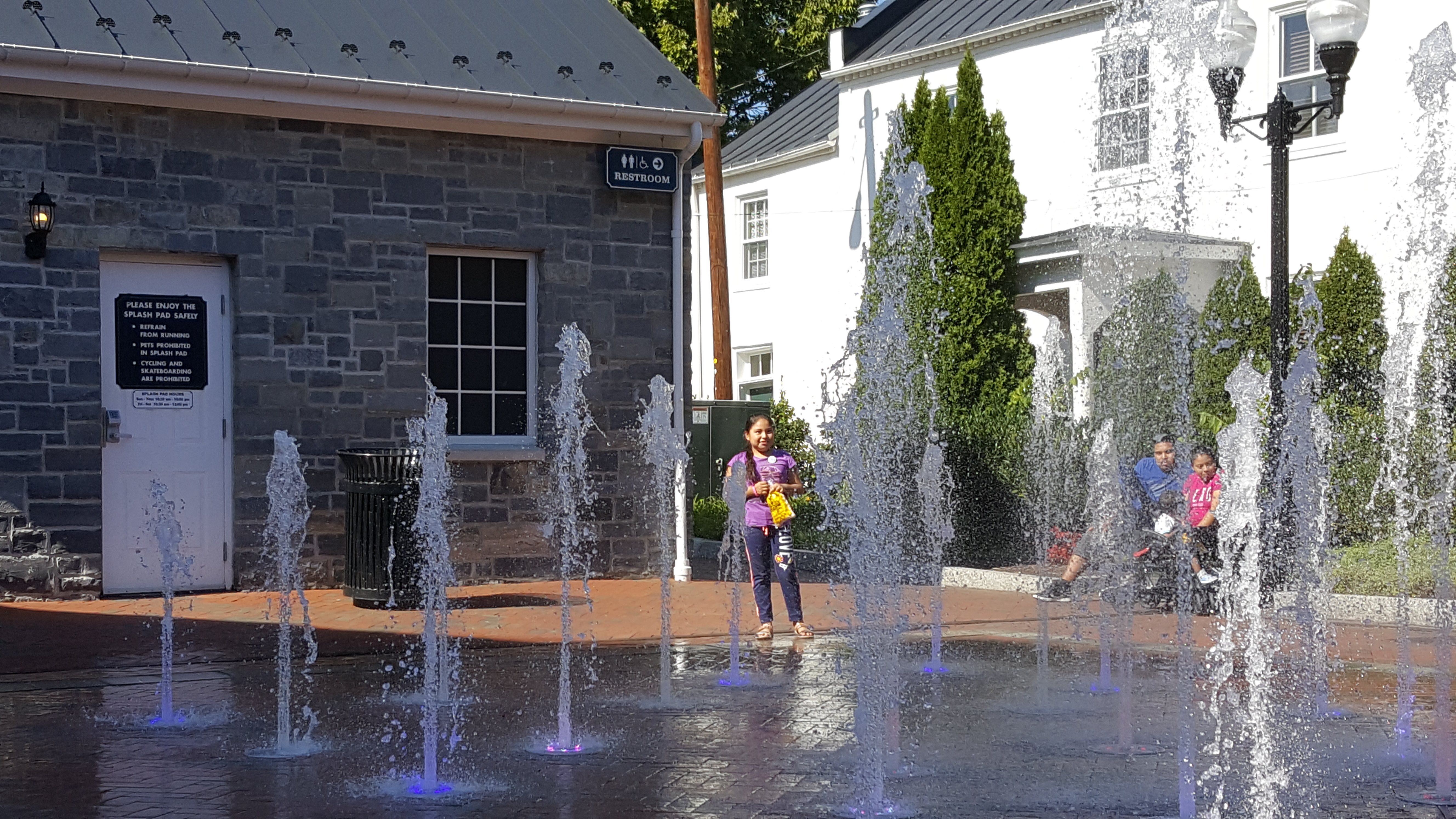 Girl enjoying water feature