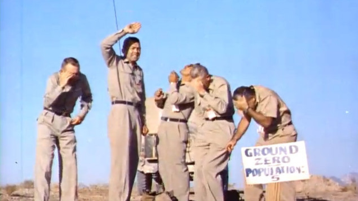 In 1957, five volunteers wait for a 2 kiloton atomic bomb to detonate directly above them. Photo credit: screen capture from U.S. government film footage.